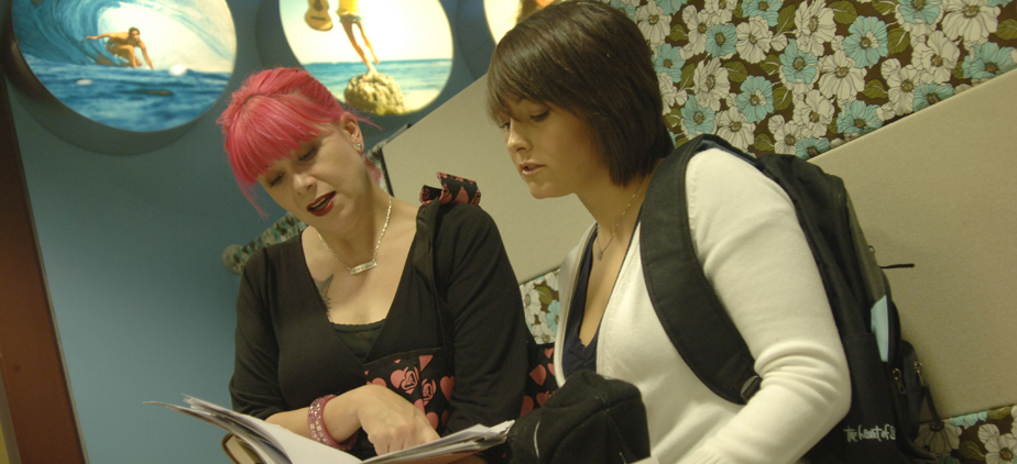 2 fashion students studying together